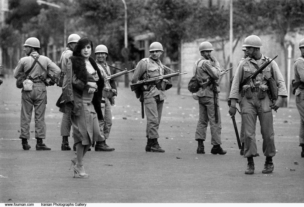 http://s2.picofile.com/file/7653206555/Tehran_Military_Curfew_Girl.jpg